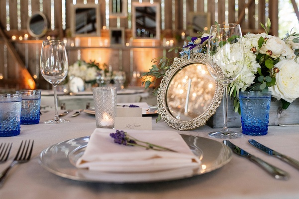 Silver mirror table number at Melissa Claire Egan's wedding