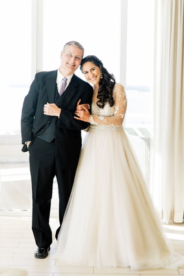 bride in long sleeve sheer wedding dress with father in three piece suit and lavender tie