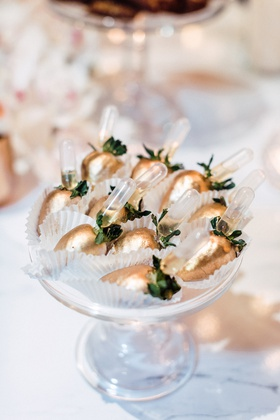 chocolate-covered strawberries with gold coating infused with alcohol