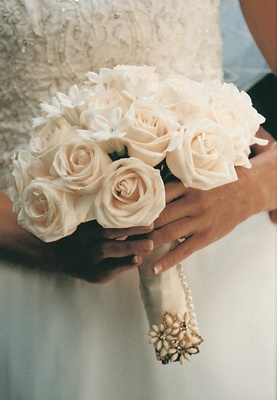Flowers wrapped in ribbon and pearls