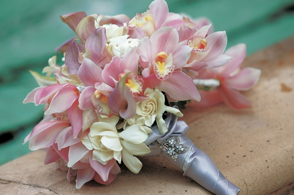 Bride's bouquet of pink orchids and calla lilies, and gardenias