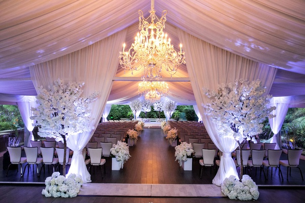 four seasons hotel los angeles at beverly hills wedding ceremony chandelier white drapery purple