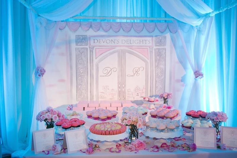 Wedding dessert table in special tent in ballroom