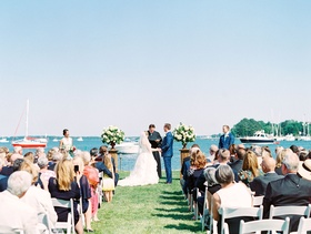Wedding ceremony outdoor summer river boats on water nautical theme coastal