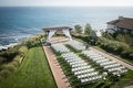 cliffside ceremony space pacific ocean white details chairs gazebo florals