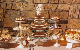 Rustic dessert table with cake and cookies