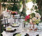 Brown charger plates and chairs with pink linens