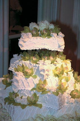 Five square-tiered wedding cake with green orchids and white roses