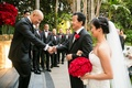 groom in giorgio armani tuxedo shakes hand of father of the bride, bride in liancarol