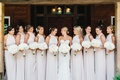 High neck halter gown bridesmaid dresses in pale pastel hue white flowers and flowers in hair