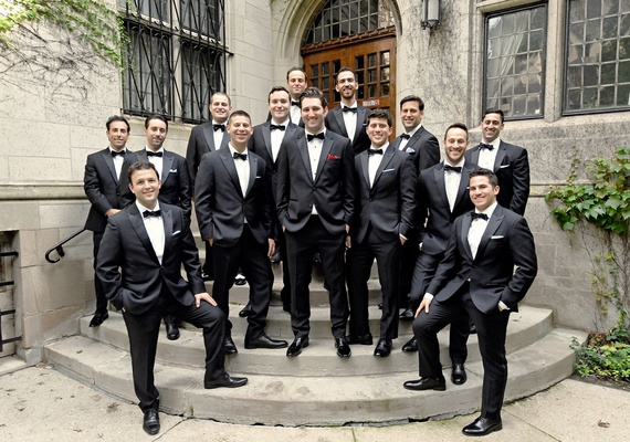 wedding photo groom in tuxedo with red pocket square groomsmen in classic tuxedos portrait