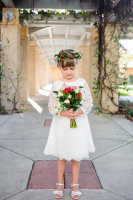 Young girl wearing sandals and floral crown