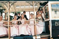 Bridesmaids and couple on tram