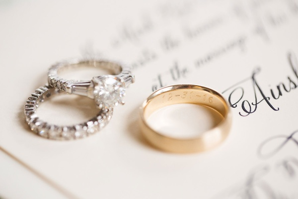Gold wedding ring engraved with wedding date for groom diamond band and engagement ring side stones