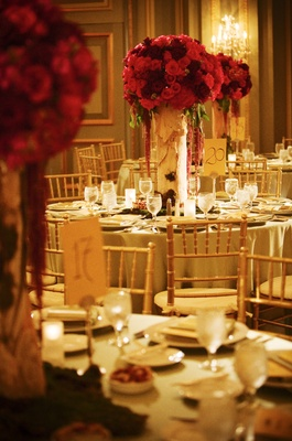 Round tables with tall floral centerpiece