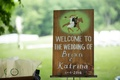 Wedding sign at favors table with wood and horse design hand written drawn details