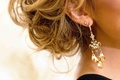 Blonde bride wearing jeweled drop earrings