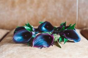 Dark purple red burgundy flower calla lily boutonnieres on seat wedding ideas