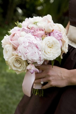 Pink and white peonies and roses in bridesmaid bouquet