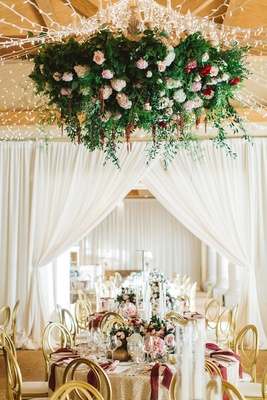 floral ceiling fixture fairy lights over reception pelican hill wedding gold red pink white flowers