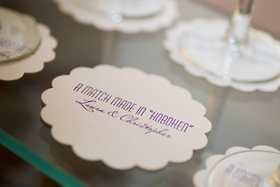 """Wedding cocktail hour coaster with couple's names and """"A Match Made in 'Hoboken'"""" quote"""
