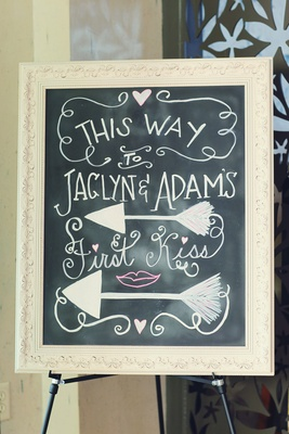 6bf1bc5411330 ... a tan · Chalkboard in white frame offers directions to ceremony ...