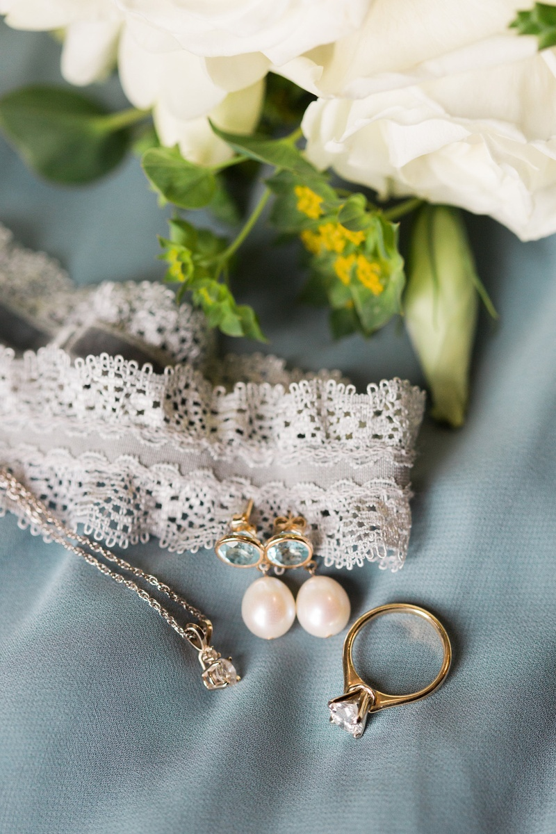 lace garter, aquamarine and pearl earrings, yellow gold solitaire diamond engagement ring