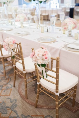 pink white floral clusters leaves gold chairs light linens low floral centerpieces