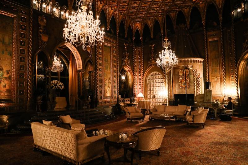 wedding reception lounge area piano player chandelier opulent decor