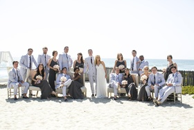 Couple with bridesmaids and groomsmen on sand