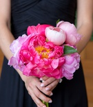 Wedding bouquet bridesmaid in draped black gown manicure white pink nails coral peony flowers