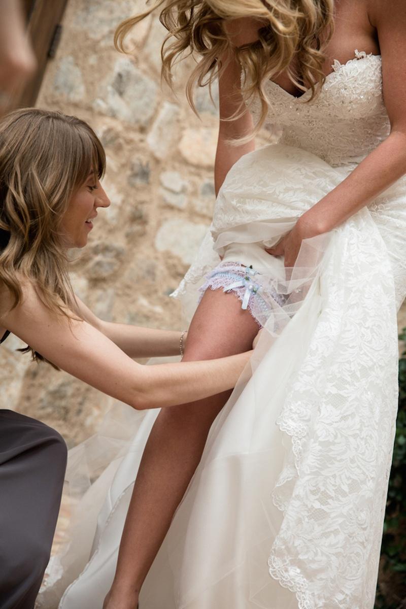 Brock Osweiler's wife with white and light blue leg garter