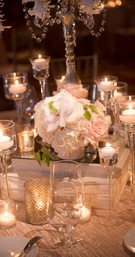 Rose and orchid jeweled centerpiece with candles at blush wedding reception