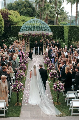 Outdoor ceremony beneath dome gazebo