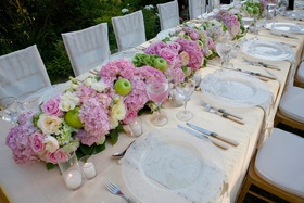 Pink and green flowers atop yellow linens