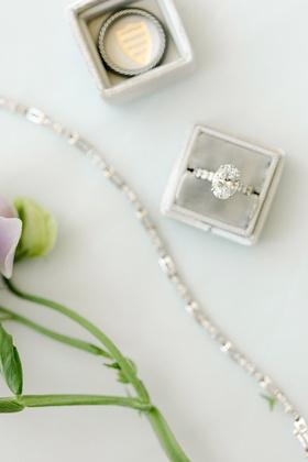 large oval diamond on large pavé band in soft grey mrs. box