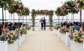 colorful flowers lining a wedding ceremony overlooking lake mendota