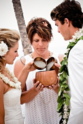 Tropical wedding leis and officiant
