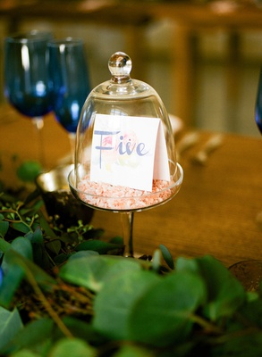 Wedding reception table number tent in glass dome mini cake dome greenery wood table