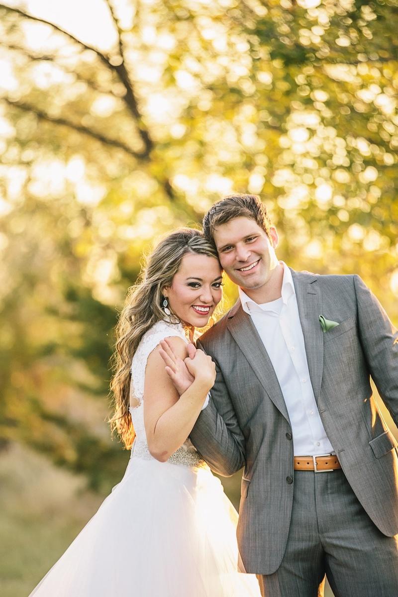 Newlyweds in semi-casual wedding attire outside