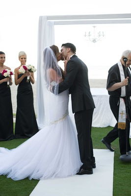 wedding ceremony acqualina resort and spa grass lawn white aisle runner mermaid dress kiss husband