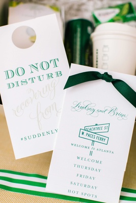 White and green paper goods for wedding welcome bag do not disturb sign wedding weekend itinerary