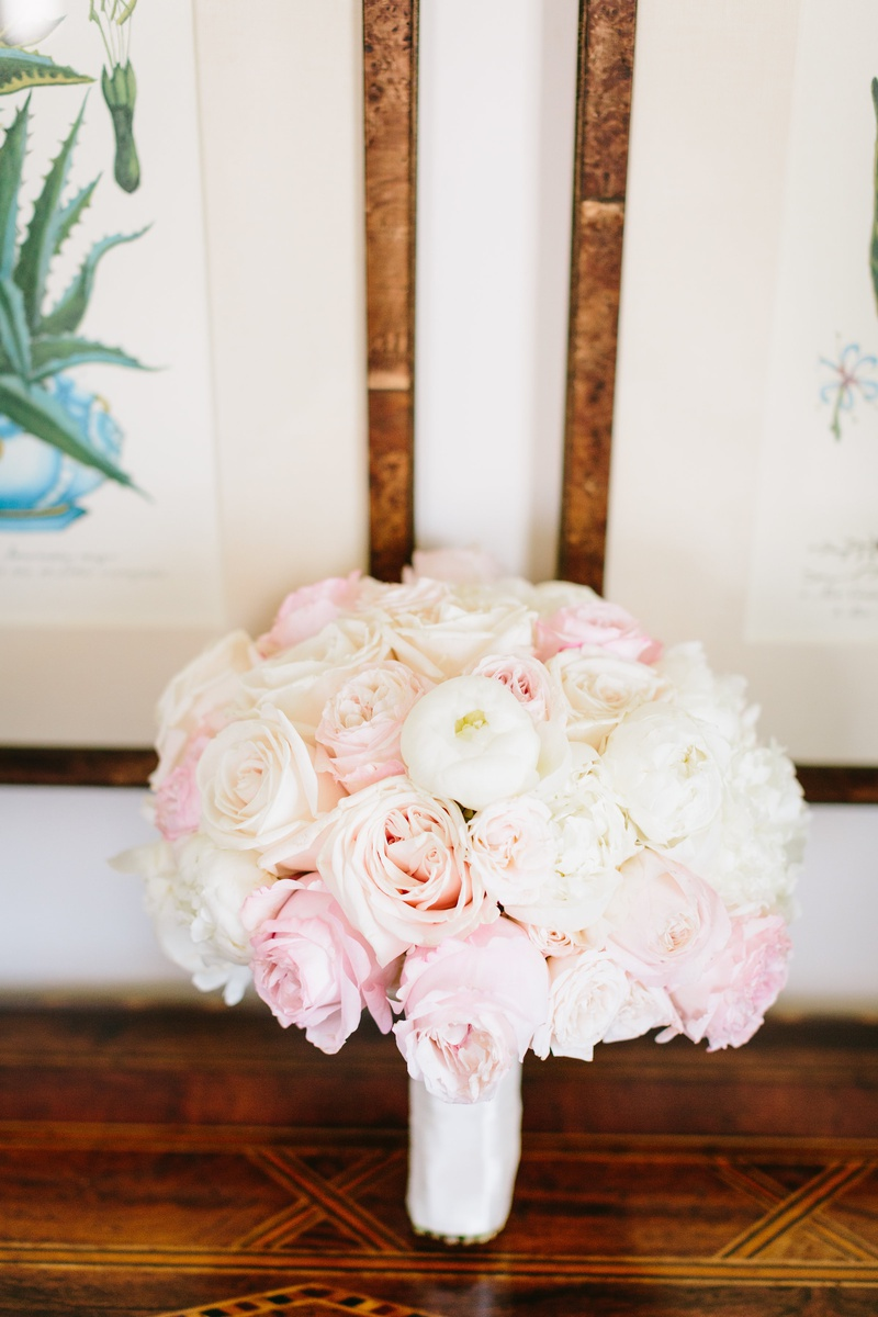 bridal bouquet with ivory and blush roses and white peonies