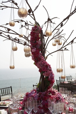 Tall centerpiece with pink flowers and candles