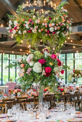 wedding reception flowers on industrial chandelier centerpiece pink white flowers colorful linens