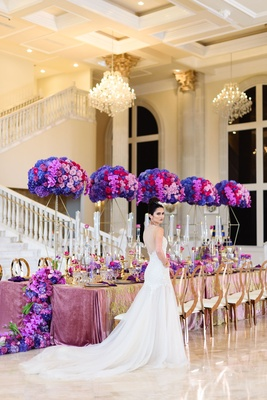 tall floral centerpieces in deep purple, lavender, pink, and red hydrangeas and roses, geometric