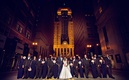 Bride and groom in navy tuxedo with bridesmaids in blue dresses and groomsmen in tuxes in Chicago