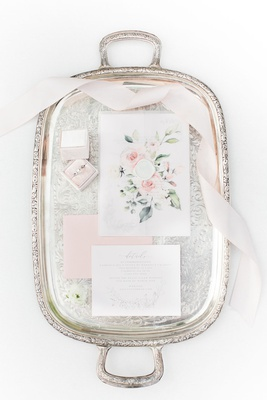 ring box, floral envelope, blush invitations on antique silver tray