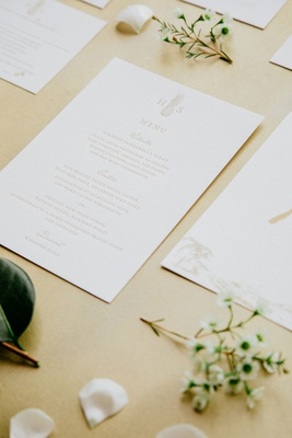 wedding stationery suite paper goods white gold details menu card with selections and pineapple