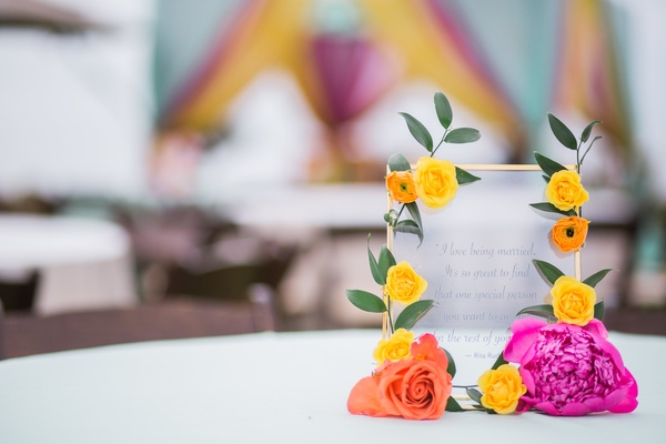mehndi in orange county, frosted glass with romantic quote with gold trim and bright flowers